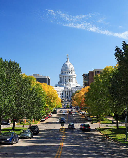 Wisconsin state capitol and street traffic Crisp photo of the Wisconsin capitol on a bright fall day. Camera: Canon 5D, 50mm lens, Adobe RGB profile. wisconsin state capitol stock pictures, royalty-free photos & images