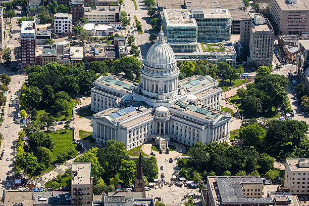 Wisconsin State Capitol from air State Capitol of Wisconsin from the air. Shot from an airplane on a Saturday during the Dane County Farmer's Market. Very sharp and contrasty image.  wisconsin state capitol stock pictures, royalty-free photos & images