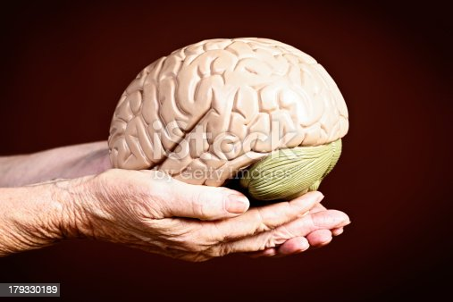 istock Wisdom or loss of mental powers? Old hands hold brain 179330189