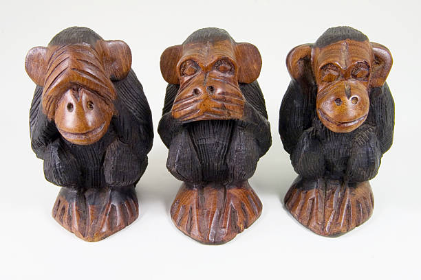 Wise monkeys that see, speak and hear no evil Three African statuettes of wise monkeys that see no evil, speak no evil and hear no evil. hear no evil stock pictures, royalty-free photos & images