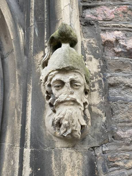 Wise old knight figurine antique stone carving stock photo