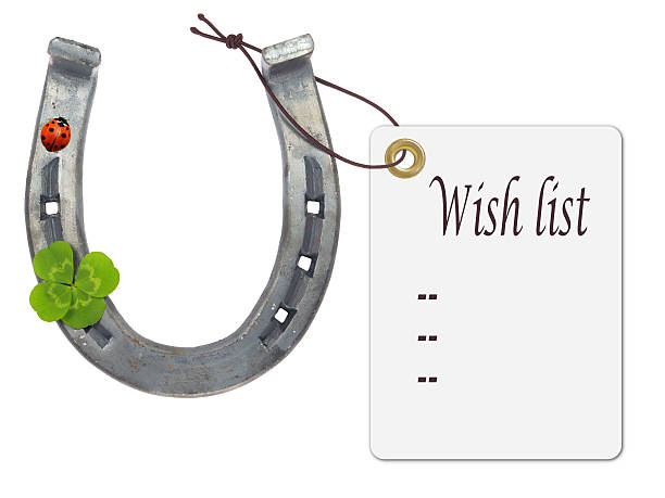 wish list on a horseshoe with four-leaf clover and ladybug - luck of the irish stock photos and pictures
