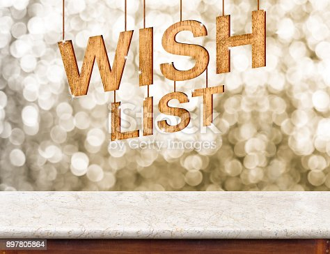 istock Wish list wood texture with sparkle star hang on marble table with sparkling gold bokeh wall,winter festive holiday celebration greeting card. 897805864