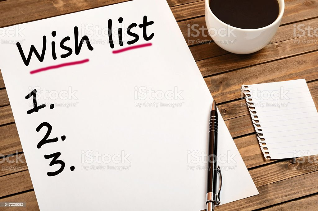 Wish List words on paper stock photo