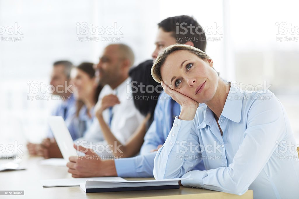 Wishing she had another job... stock photo