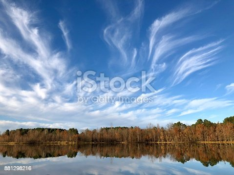 Majestic sun and clouds on blue sky