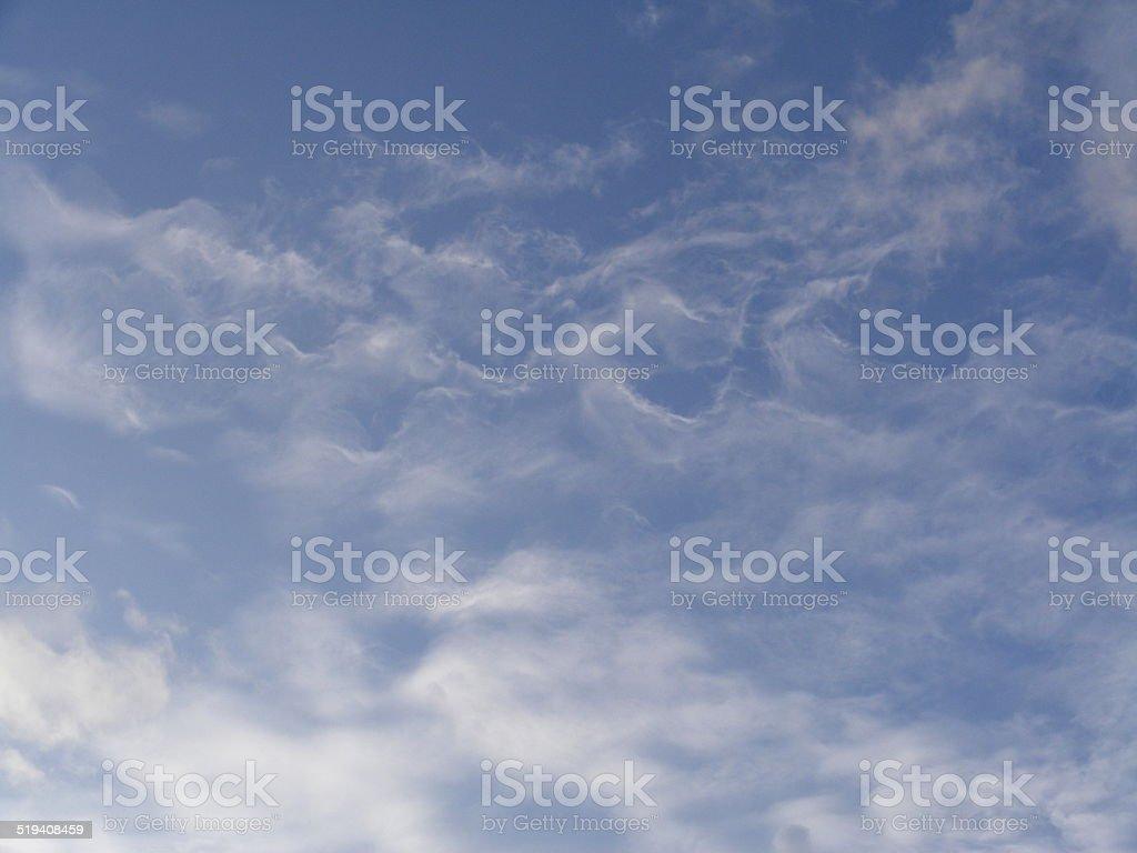 Wispy Gossamer White Clouds Swirled on Carolina Bright Blue Sky stock photo