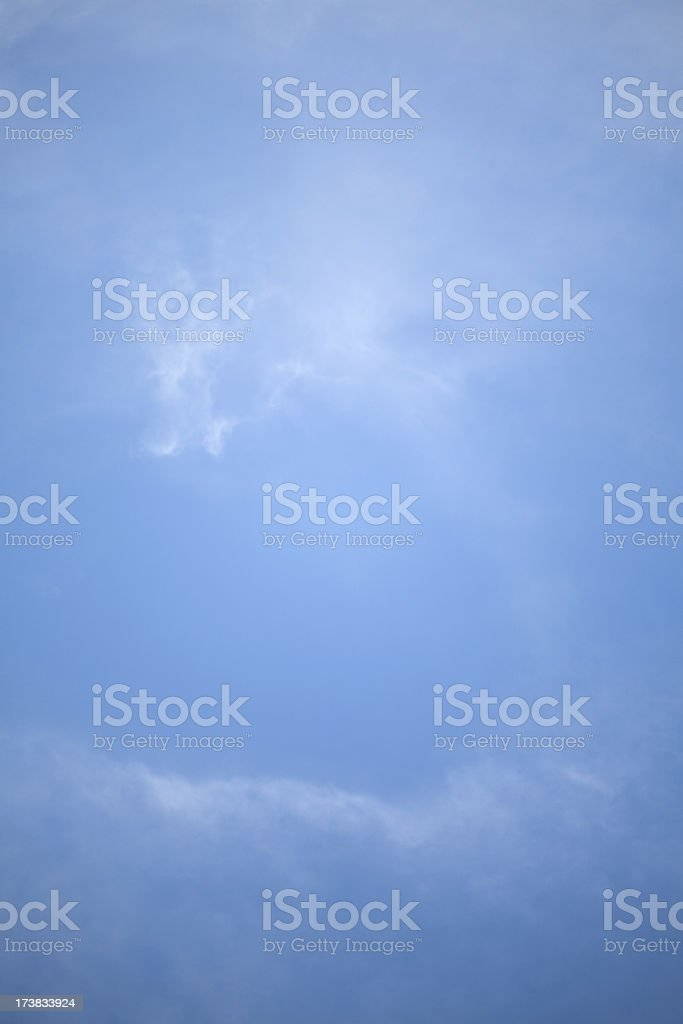 Wispy White Cirrostratus Clouds as a Frame in Blue Sky royalty-free stock photo