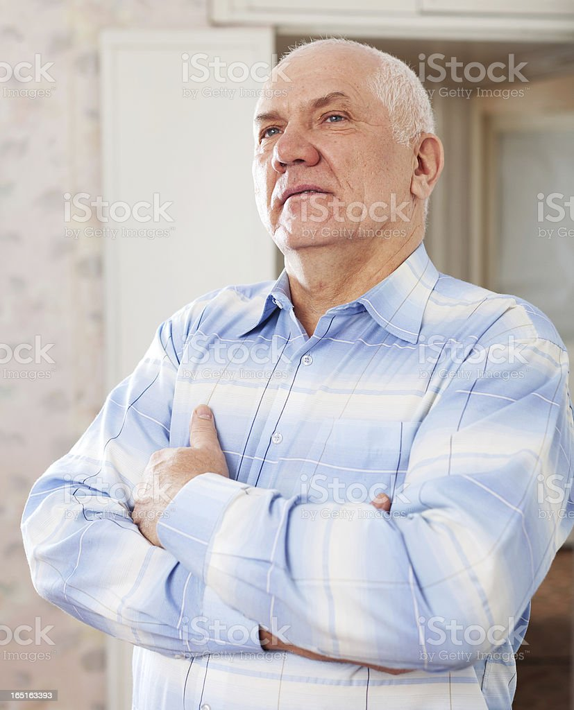 wistful grizzled elderly man royalty-free stock photo