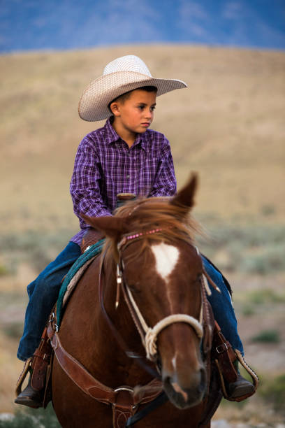 Wistful Young Cowboy stock photo