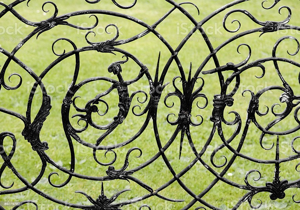 witch and witchcraft symbols on a wrought iron gate royalty-free stock photo