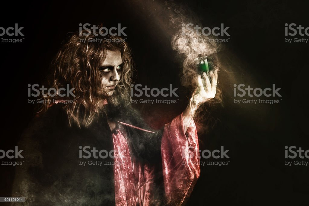 witch drinking potion stock photo