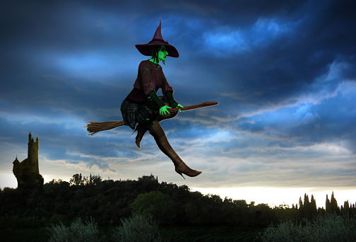 istock Witch Flying on a Broomstick 624909452
