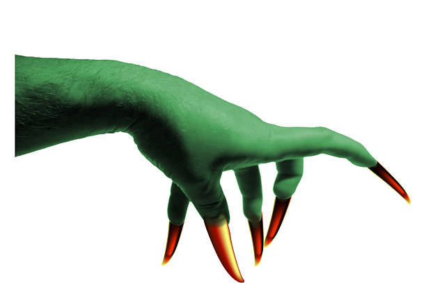 Witch Hand with Claws Scary witch hand. Green skin, yellow claws. claw stock pictures, royalty-free photos & images