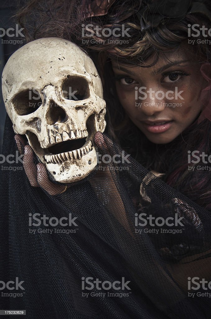 Witch Holding a Human Skull royalty-free stock photo