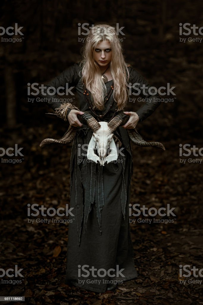 Witch in a long black dress stock photo