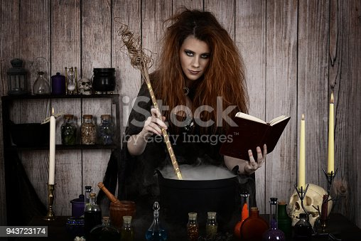 istock witch in her cottage making a magic potion 943723174