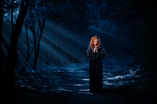 istock Witch in night forest 861342650