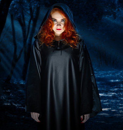 istock Witch in night forest 861342652