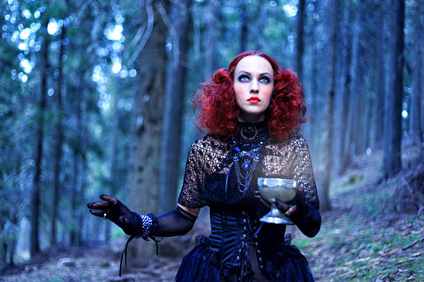 Witch in the forest. Halloween theme Witch in the forest. Halloween theme goth stock pictures, royalty-free photos & images