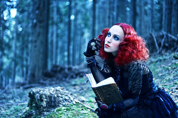Witch in the forest rading book. Halloween theme Witch in the forest rading book. Halloween theme goth stock pictures, royalty-free photos & images