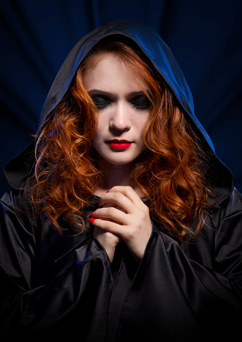 istock Witch on blue rays background 517715929