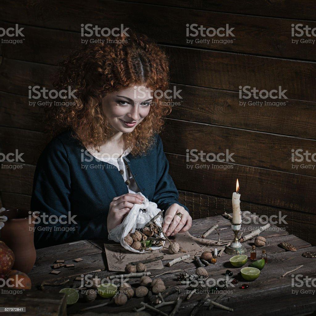Witch preparing potion stock photo