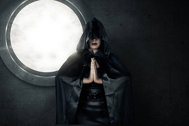 Witch wearing black hood stock photo
