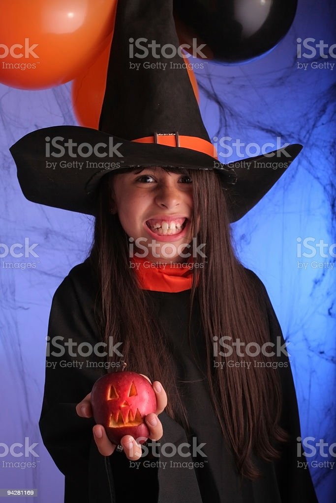 Witch With Apple in Halloween Party royalty-free stock photo
