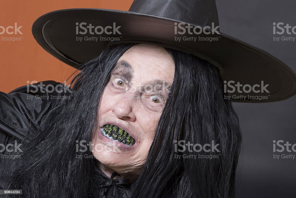 Witch with green teeth stock photo