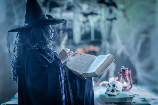 Witch With Magic Book stock photo