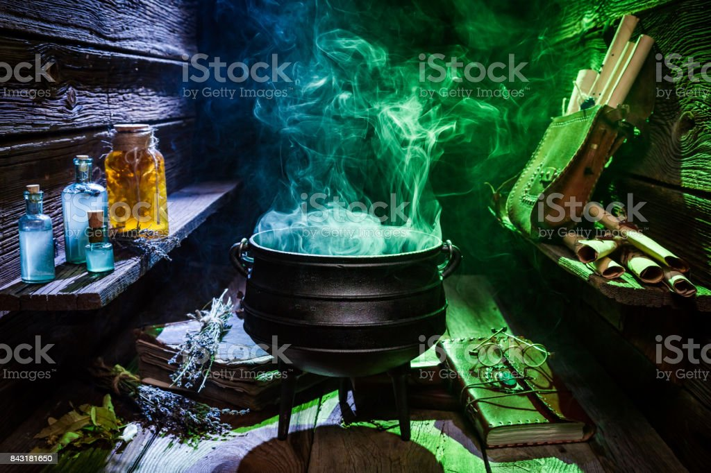 Witcher cauldron with color smoke for Halloween stock photo
