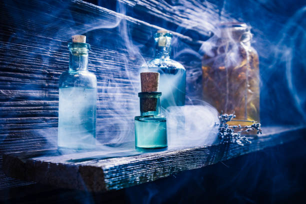 Witcher cottage with blue magic potion for Halloween stock photo