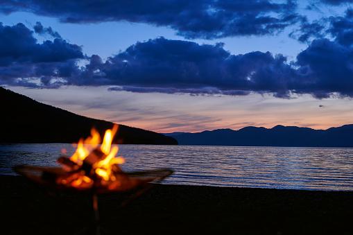 With a bonfire at dusk at Lake Shikotsu