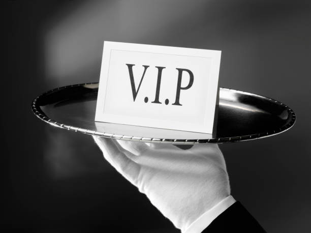 V.I.P. with a First Class Service First class service. Waiter holding a Very important person VIP card on a silver tray. Click on the link below to see more of my business images. first class stock pictures, royalty-free photos & images