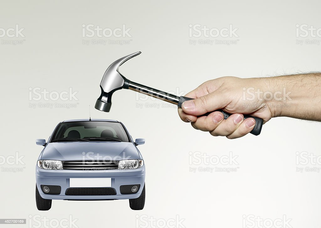 With a hammer to break the car protested, protect green stock photo