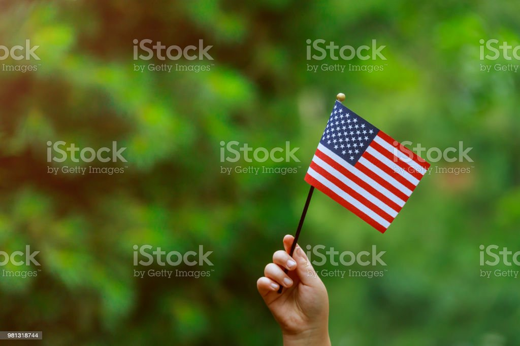 with american flag in her hand Independence Day, Flag Day concept stock photo