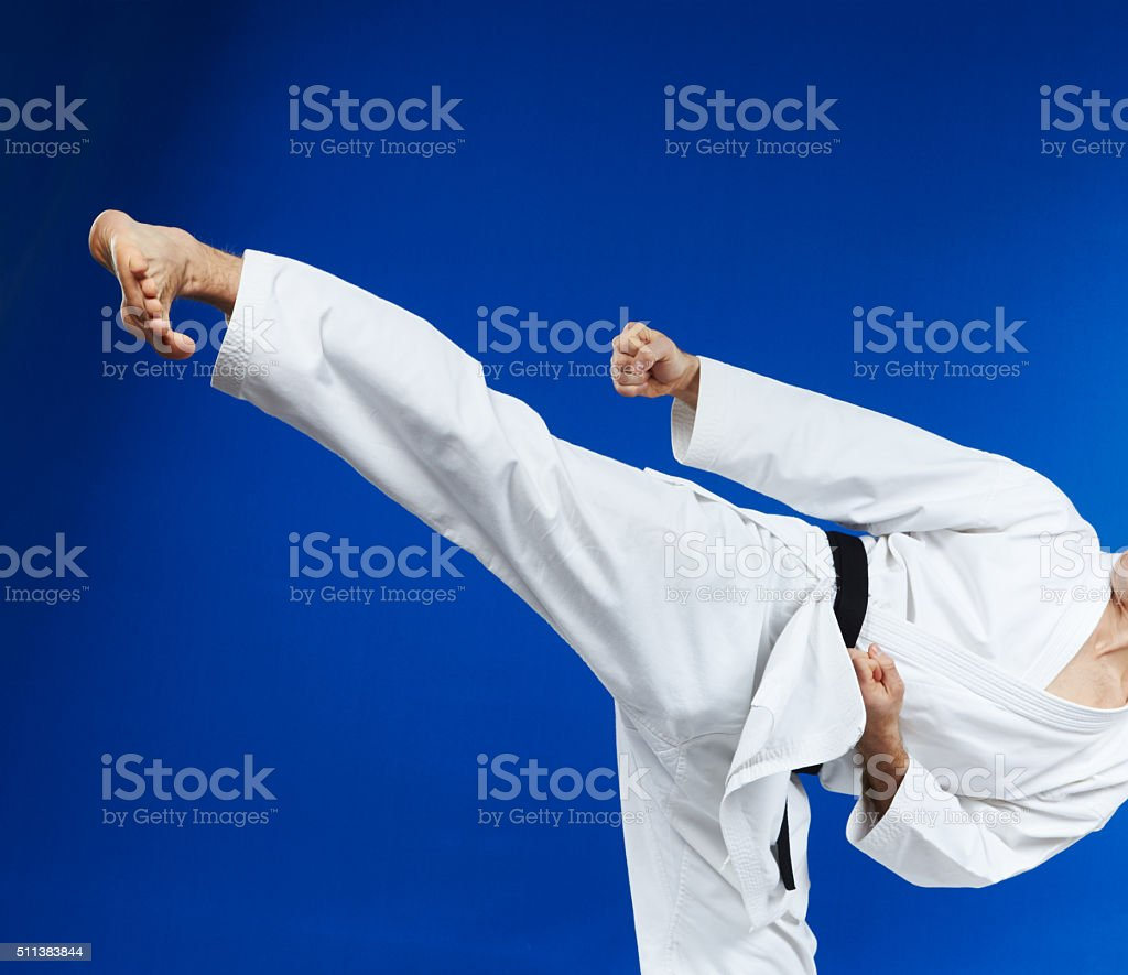 With black belt the athlete are beating kicking stock photo