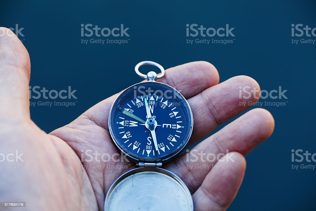 With Compass in Hand stock photo