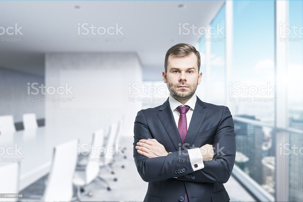 CEO with crossed hands in the modern conference room. stock photo