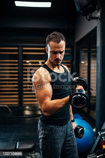istock With every workout he gains more strength 1207106685