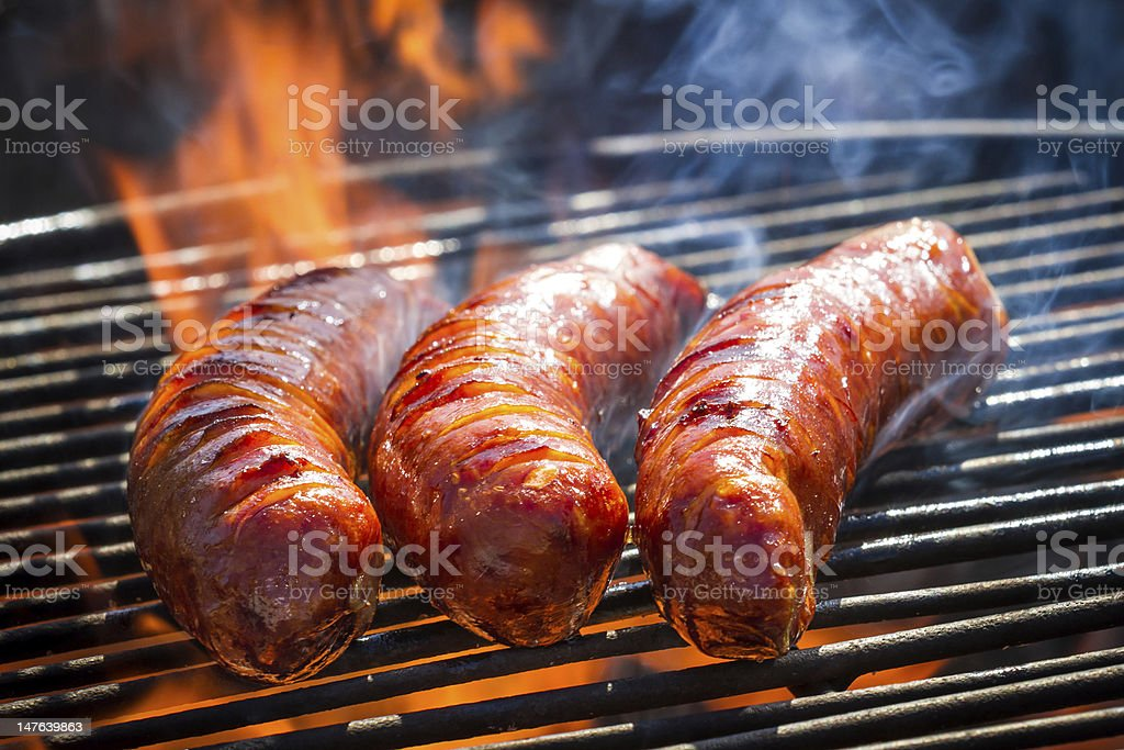 BBQ with fiery sausages on the grill stock photo