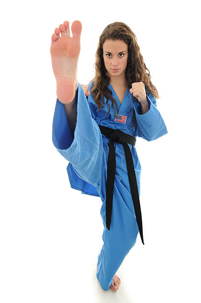 with fists and feet - karate stock photos and pictures