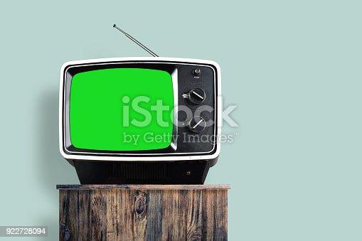 istock TV with green screen on wood furniture 922728094