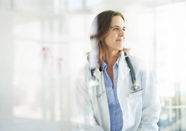 with her, good health is in sight - physician stock photos and pictures