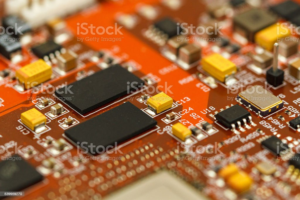 PCB with ICs, chip capacitors, and chip resistors stock photo