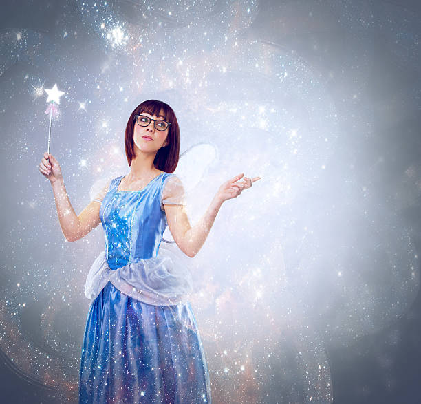 with just a touch of fairy dust... - fairy wand stock photos and pictures