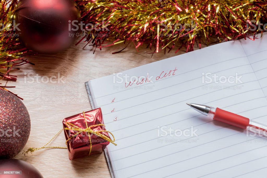 with list on 2018 new year. notebook and black pan on table...