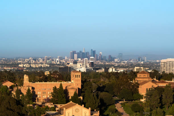UCLA with Los Angeles Sunset picture of the University of California, Los Angeles (UCLA) with the skyscrapers of downtown Los Angeles in the background. westwood neighborhood los angeles stock pictures, royalty-free photos & images