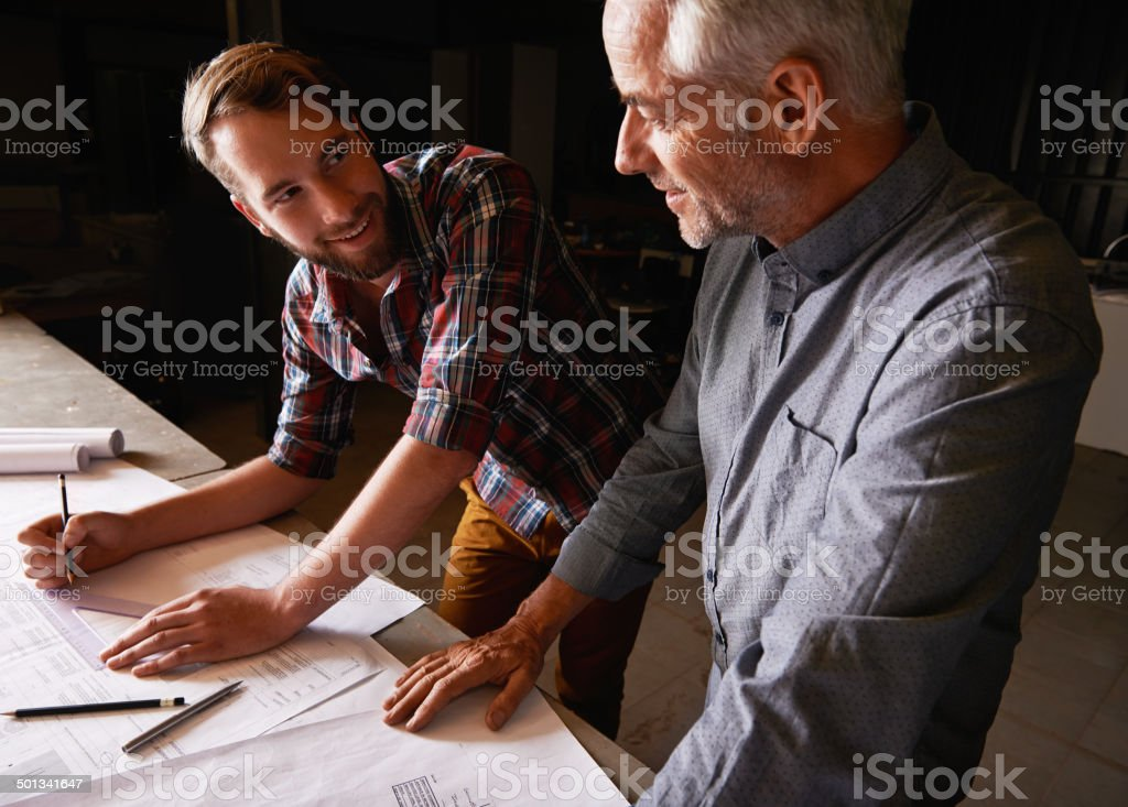 With men it's all about getting the measurements right stock photo